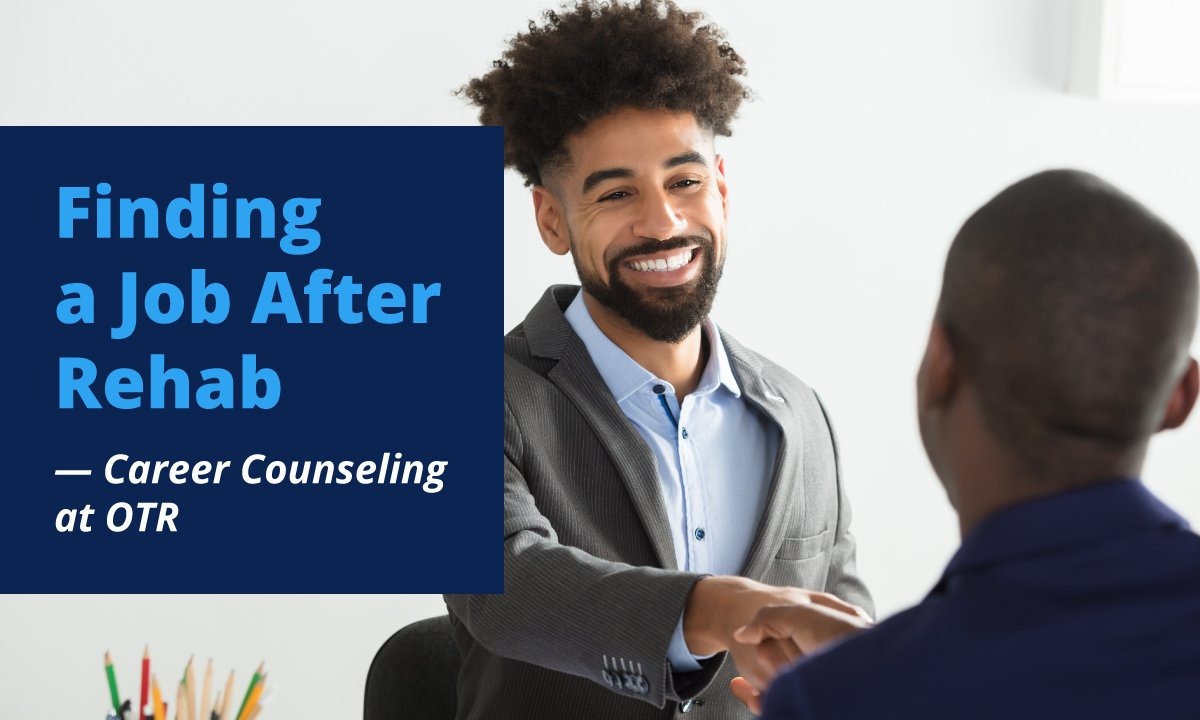 african american shaking hands with another man during job interview